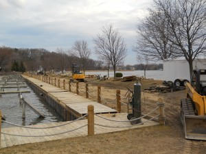 Custom boardwalk being installed in Waterford on Cass Lake in Oakland County Michigan.