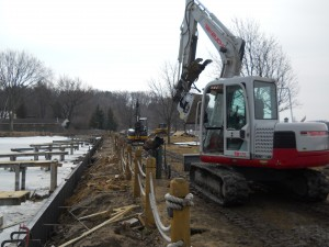 Seaside seawalls installing a steel seawall in waterford michigan on cass lake