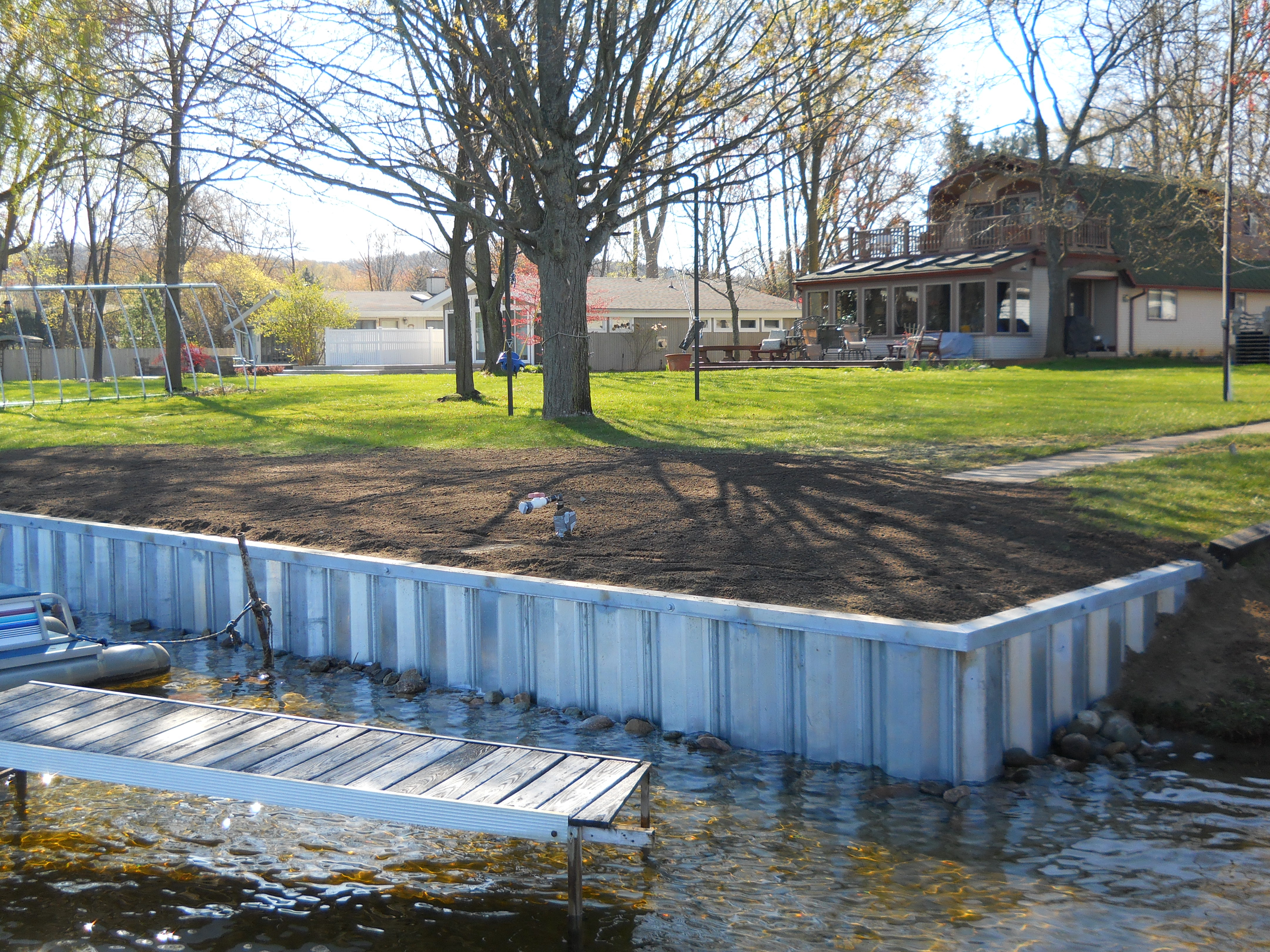 Steel seawall install on portage lake in pinckney mi for Build a lake
