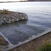 Side view of inlet that we changed look with nice stones in Sylvan Lake, MI