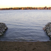 """Changing look of steel inlet with 12-18"""" stones on Sylvan Lake"""