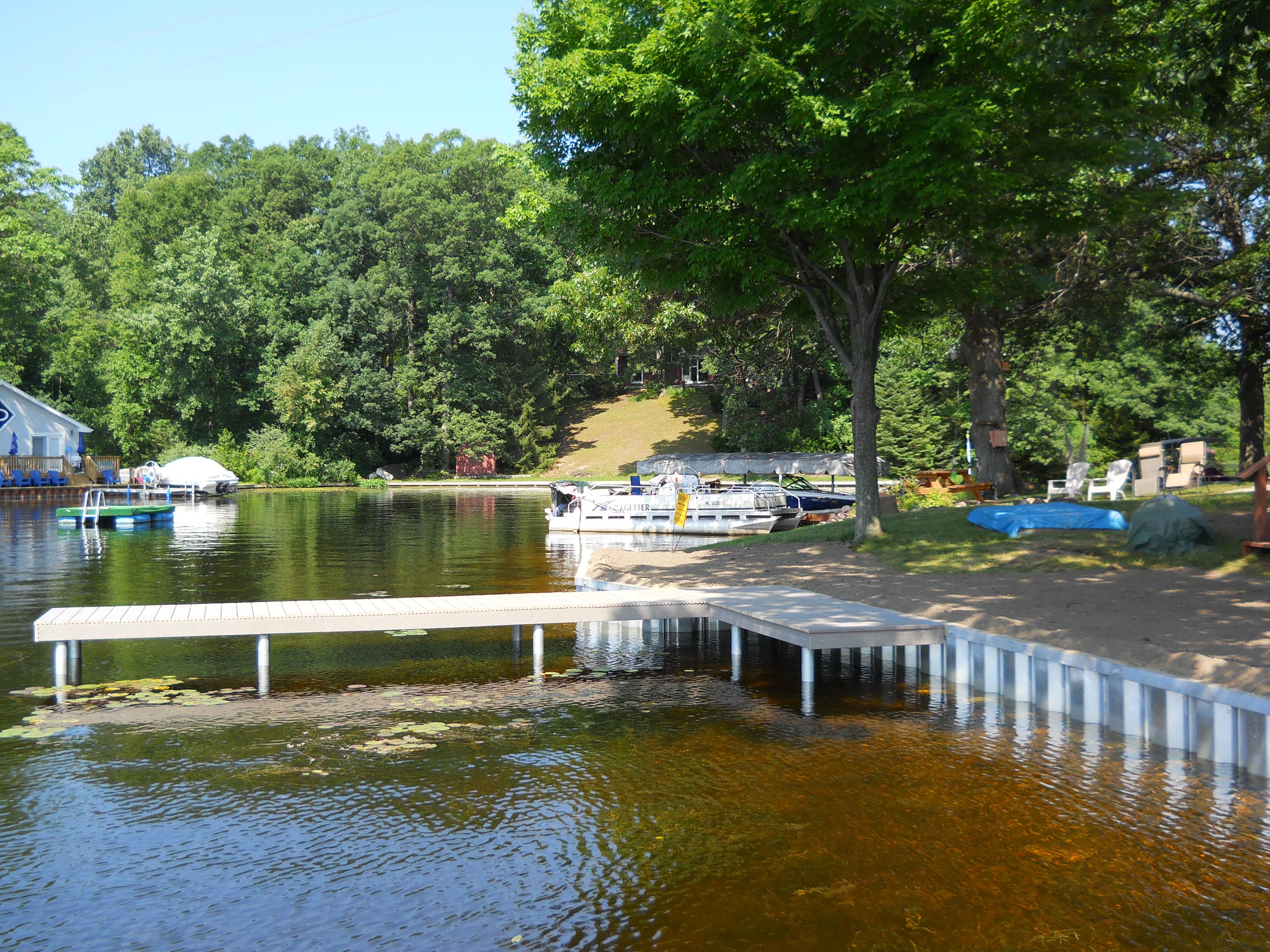 galvanized steel seawall-platform deck-L-shaped dock-Hiland Lake-Pinckney Michigan