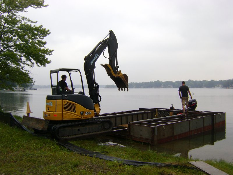 excavator to build black steel seawall